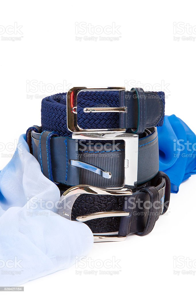 Three leather belt and a blue silk scarf isolated stock photo