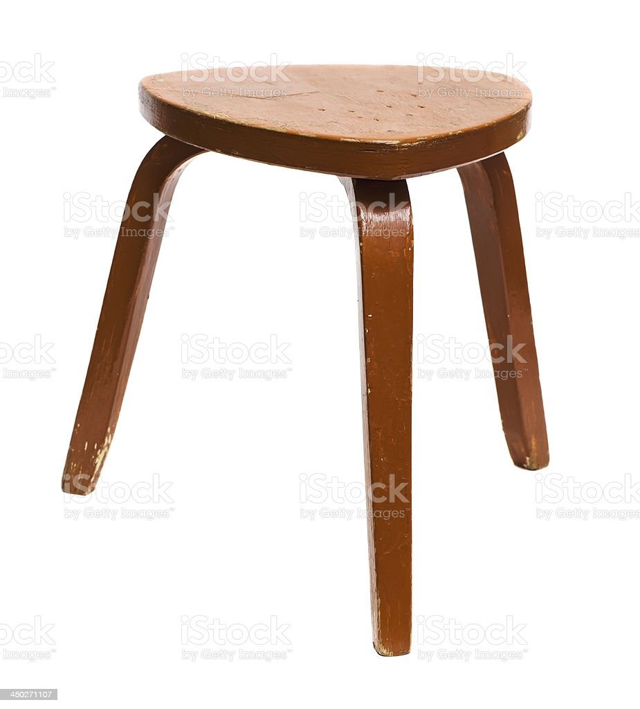 Three legged triangle shaped wooden foot stool stock photo