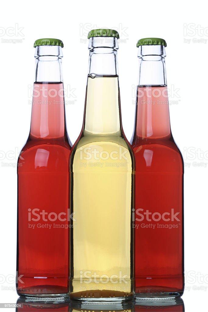 Trois bouteilles de rouge jaune citron photo libre de droits