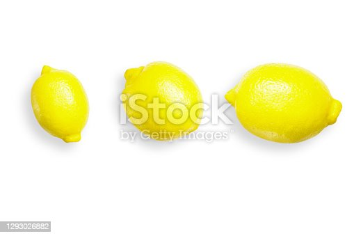 Three lemons isolated on a white background . Lemons is a natural source of vitamin c .
