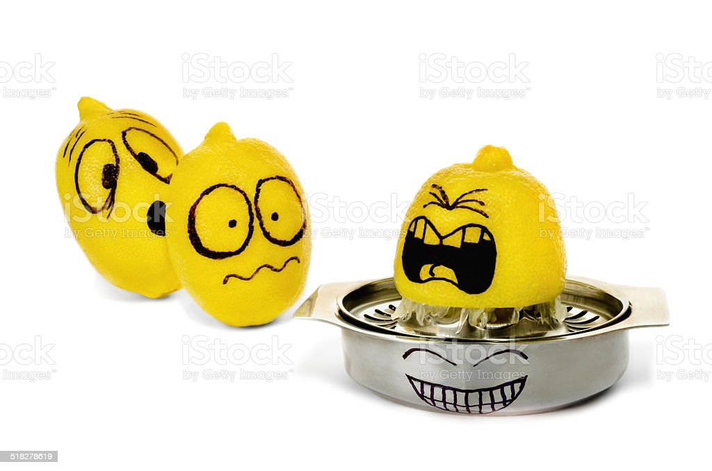 Three lemons with funny painted emotions squeezing on strainer. stock photo