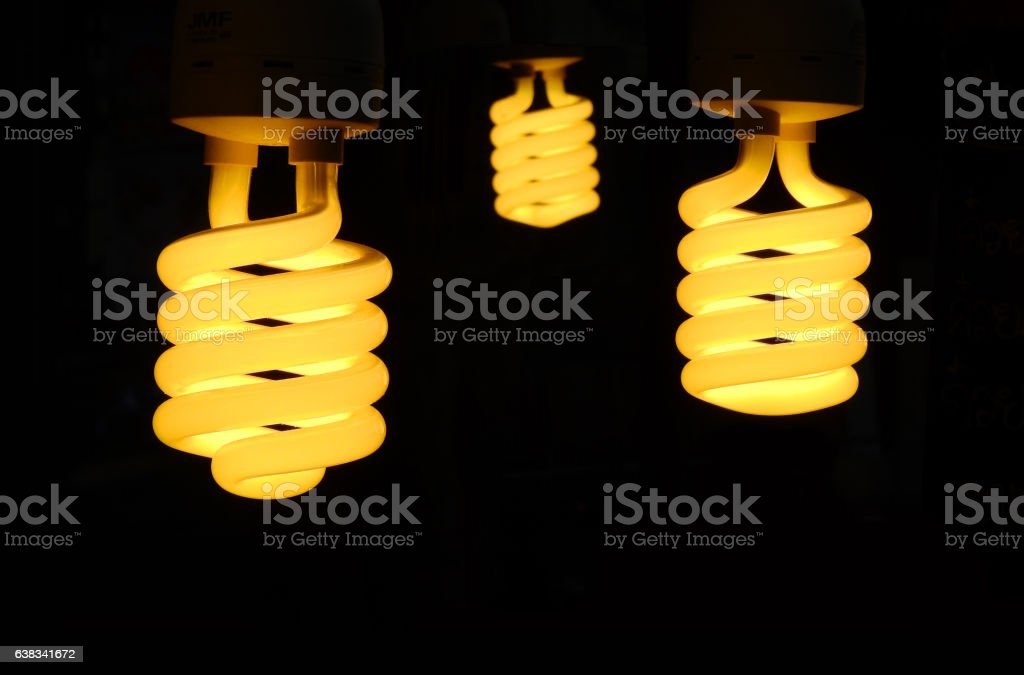 Three light bulb turn on with black. stock photo