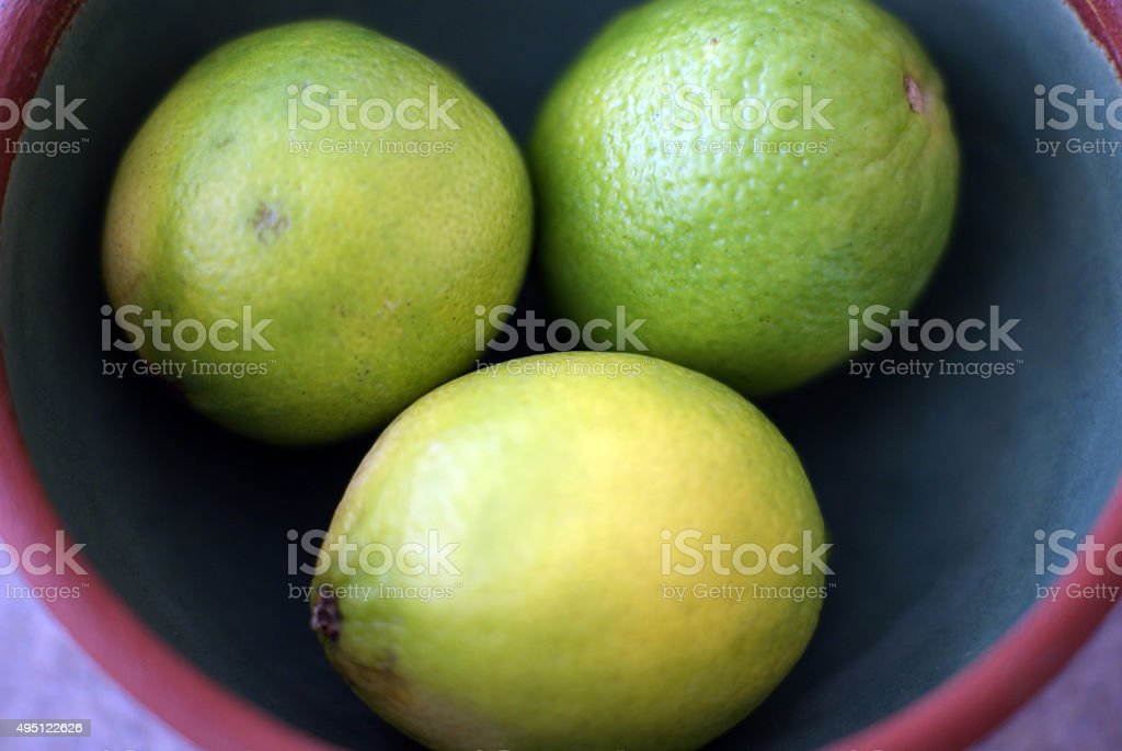 Three Limes in a Bowl stock photo