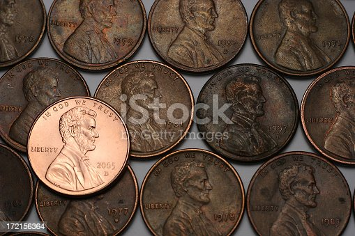 A new shiny Lincoln with older dull pennies in the background
