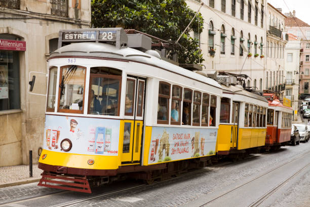three lisbon tramcars - three roads uphill bildbanksfoton och bilder