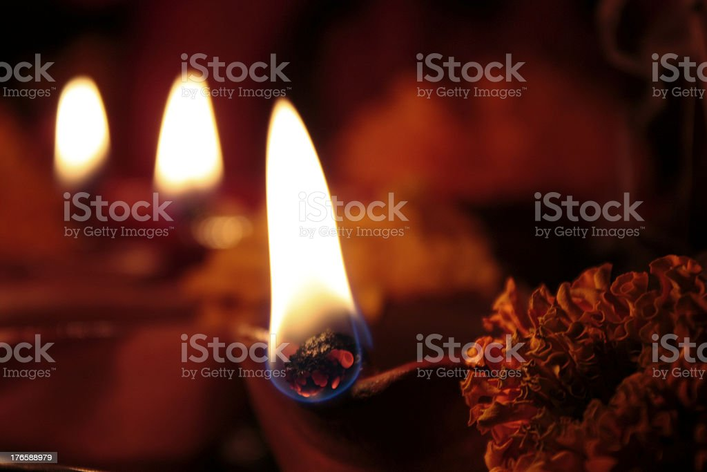 three lit earthen oil lamps(diya) on diwali stock photo