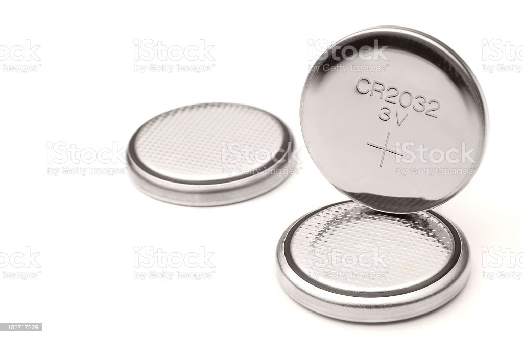 Three lithium battery cells on white background stock photo