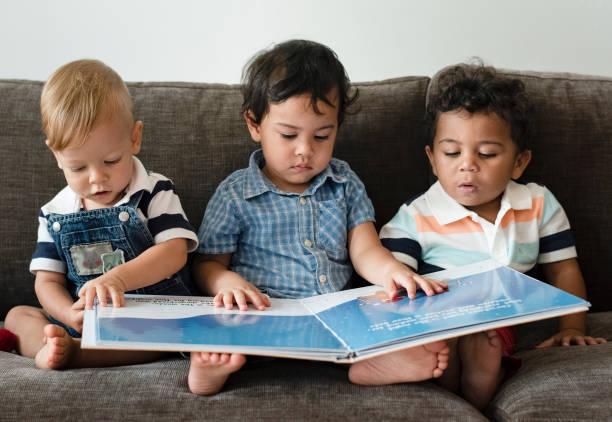 Three little boys reading a book on a sofa picture id1069933526?b=1&k=6&m=1069933526&s=612x612&w=0&h=1hqbgefpj gjjbcnuwr1vhhg8usr8ze9ihav yubavw=