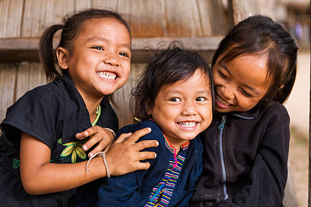 Three little girls in Northern Laos Three little girls having fun in the village in Northern Laos. developing countries stock pictures, royalty-free photos & images