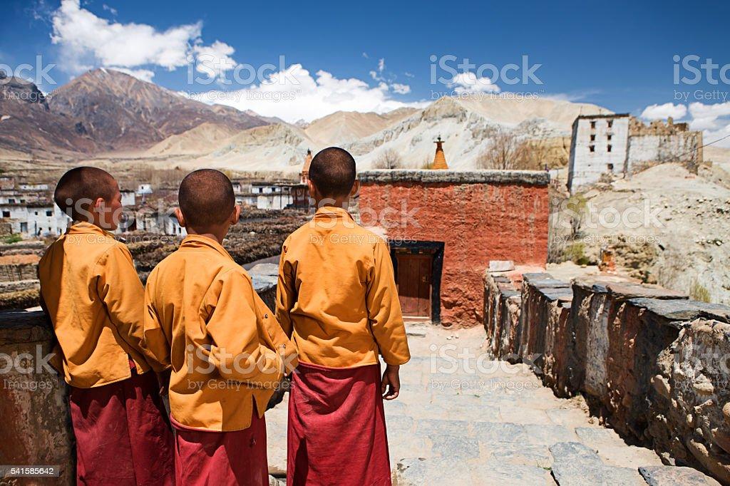 Three little Novice monks in Tibetan monastery, Upper Mustang stock photo