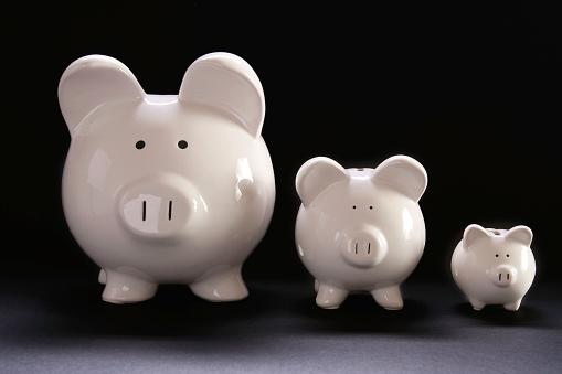 Three white piggy banks