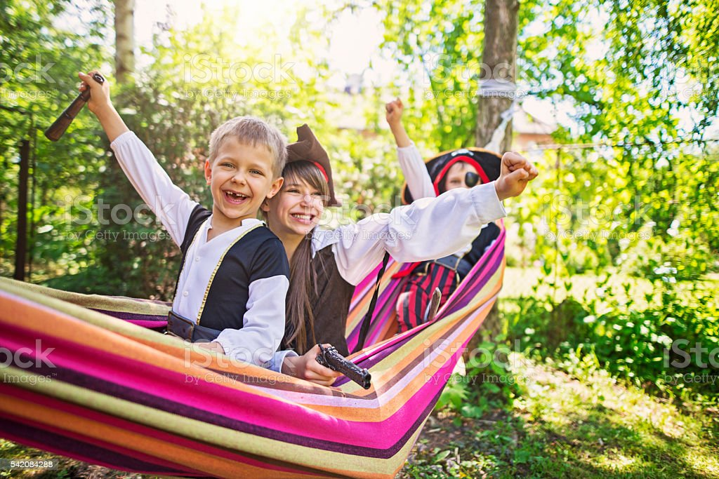 Three little pirates on hammock boat stock photo