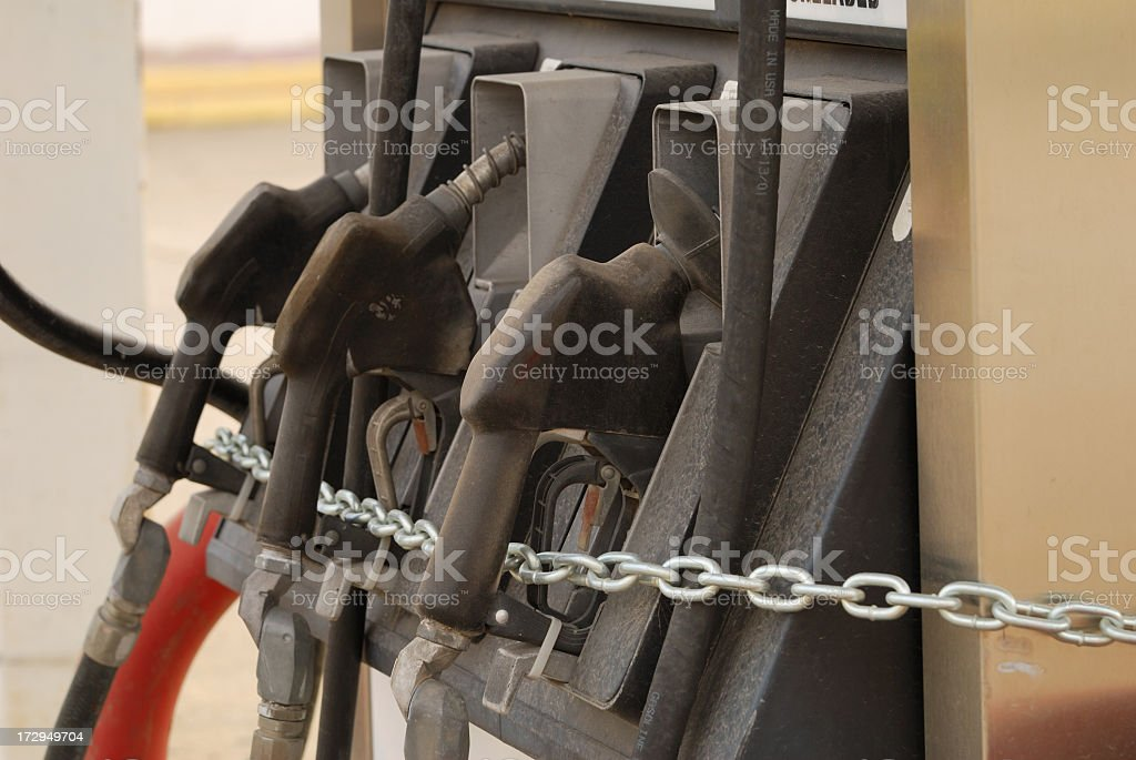 Three locked up fuel pump handles stock photo