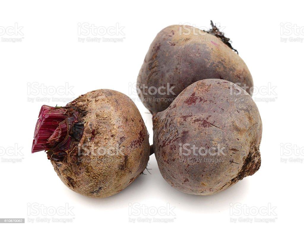 three loose beet roots on white stock photo