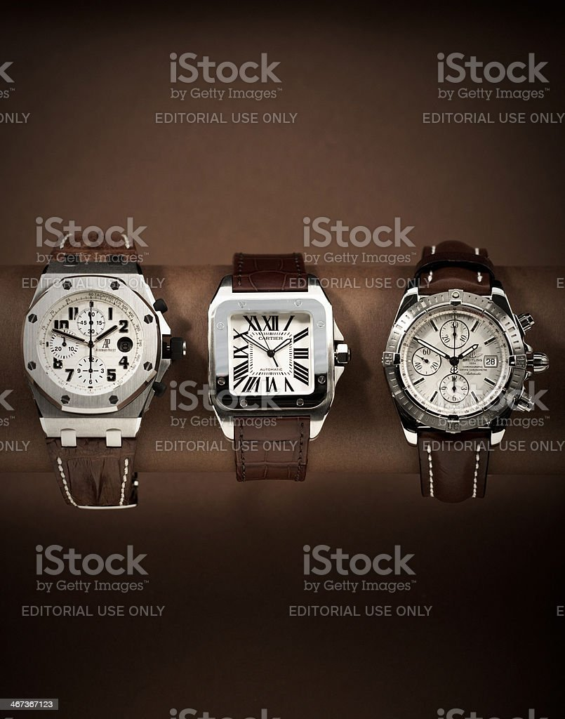 Three luxury watches in a row stock photo