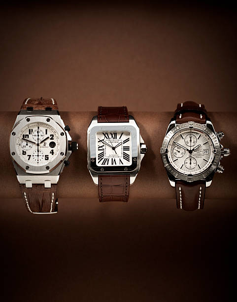 Three luxury watches in a row Amsterdam, Netherlands - March 3, 2009: Three luxury watches in a row luxury watch stock pictures, royalty-free photos & images