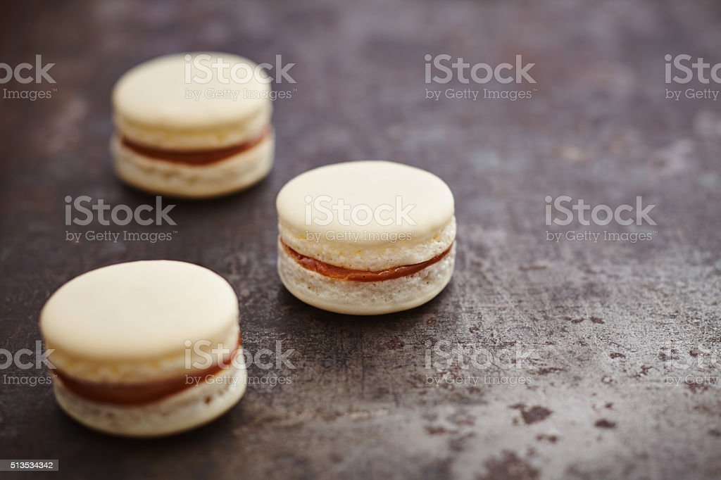 Three macarons with caramell filling stock photo