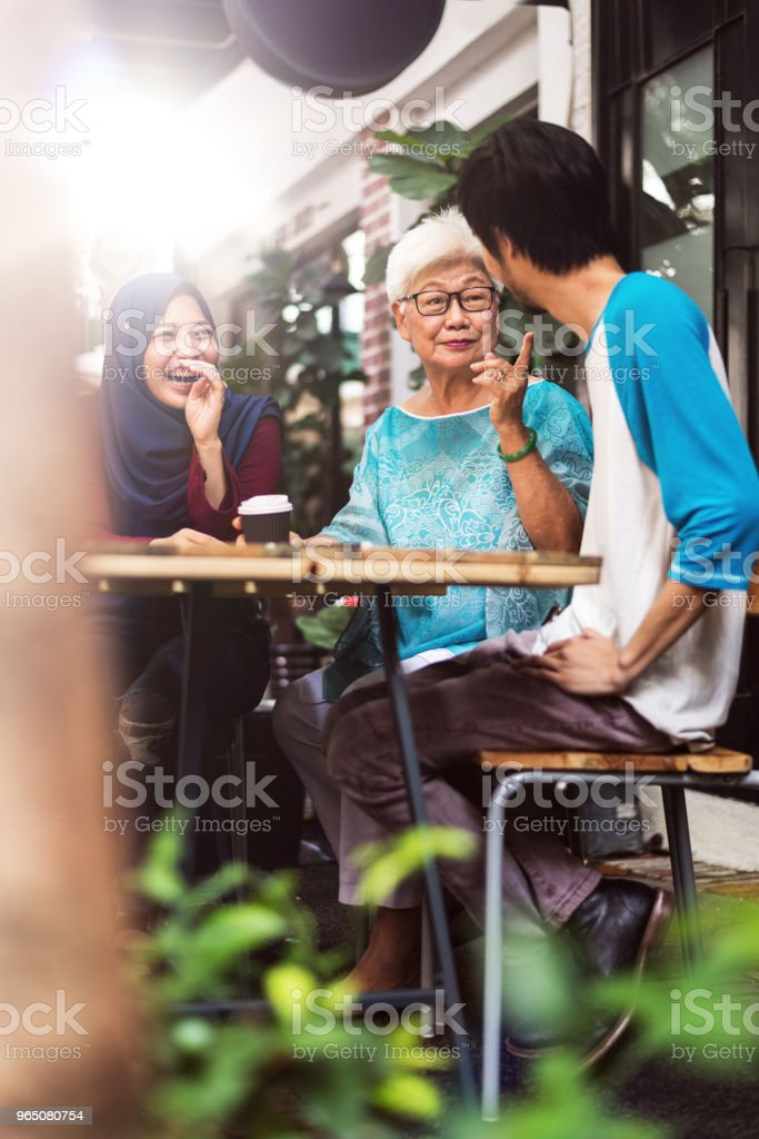 Three malay friends talking to each other and laughung zbiór zdjęć royalty-free