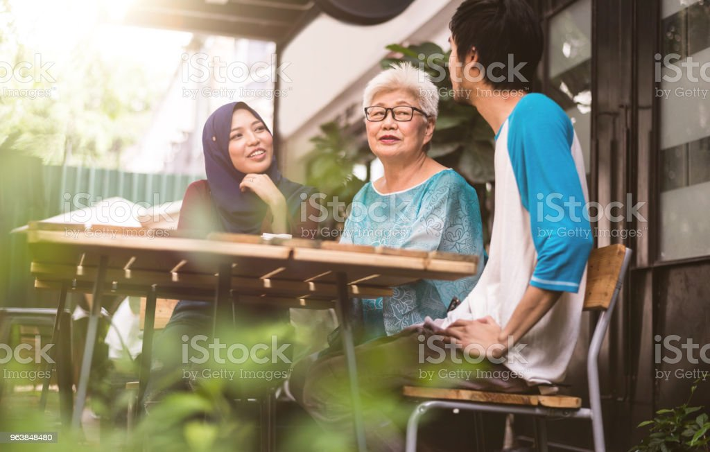 Three malay friends talking to reach other - Royalty-free Active Seniors Stock Photo