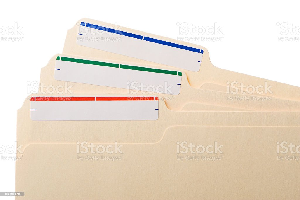Three manila folders with colored labels stock photo