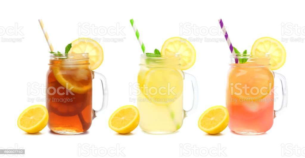 Three mason jars of summer iced tea, lemonade, and pink lemonade drinks isolated on white - Photo