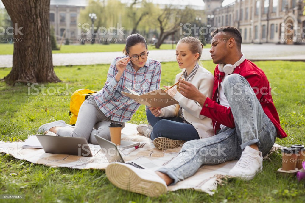 Three master degree students participating in business project royalty-free stock photo