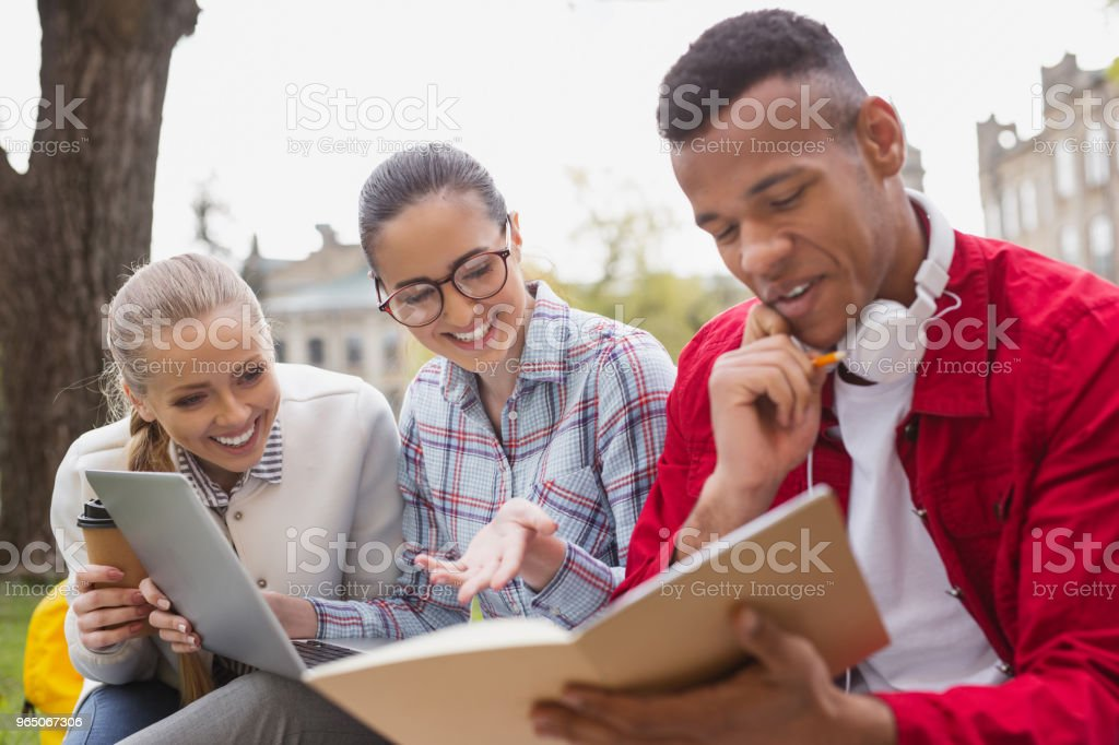 Three math students feeling happy after figuring out problem royalty-free stock photo