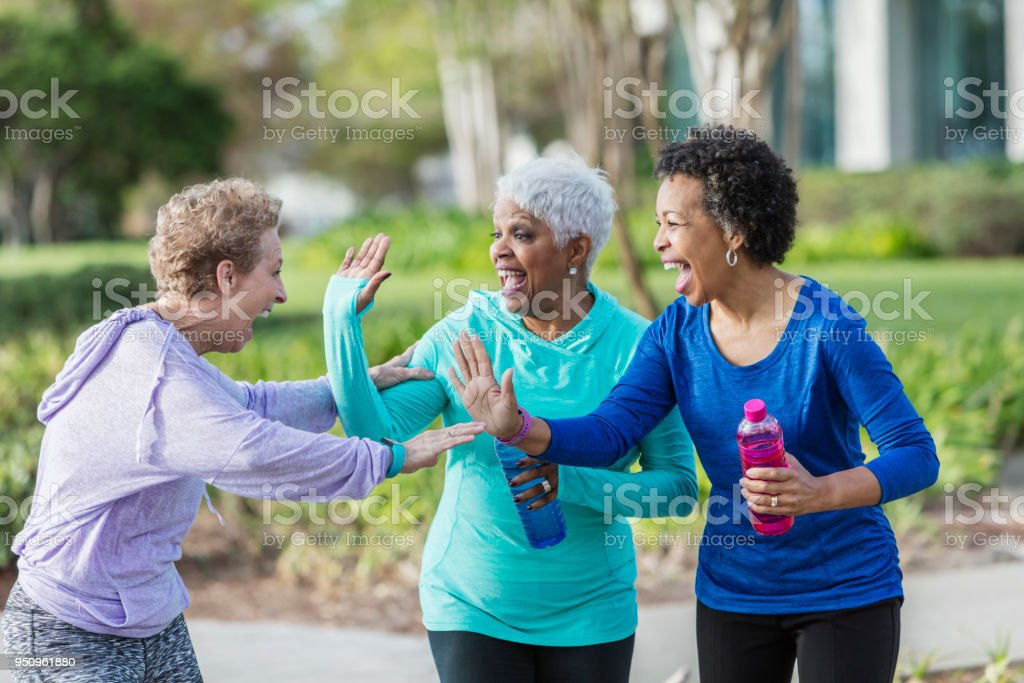 A group of three multi-ethnic mature and senior women in their 50s...