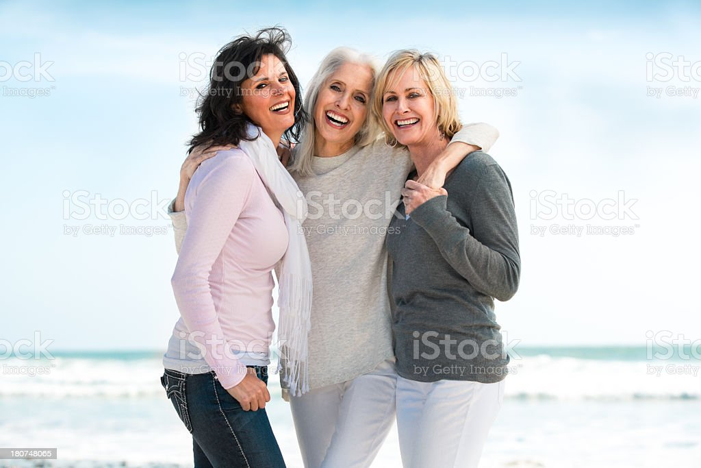Three mature women smiling big stock photo
