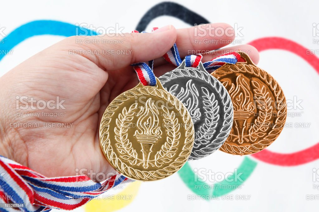 Three medals with Olympic Flag stock photo