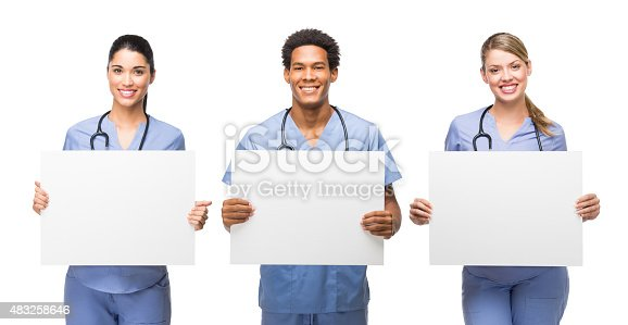istock Three medical professionals holding banners 483258646