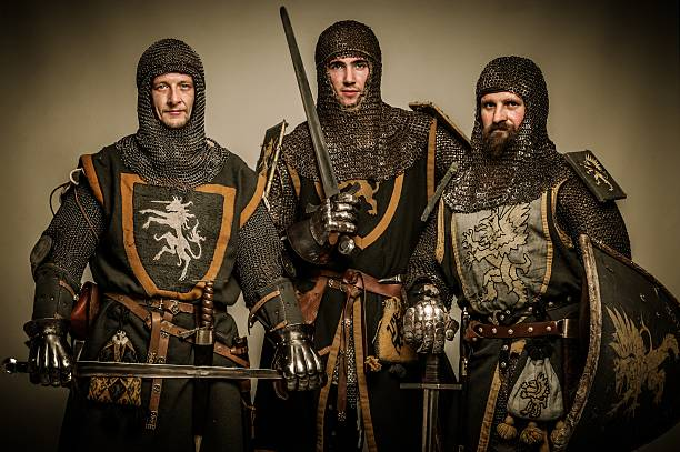 three medieval knights - the crusades stock photos and pictures