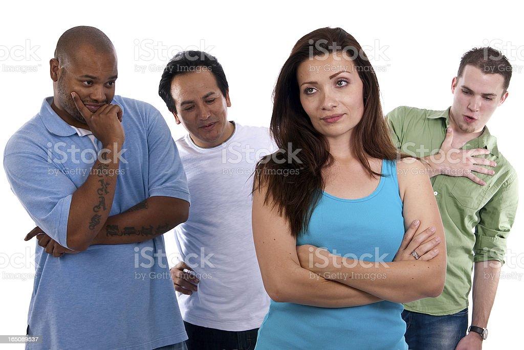 Three men checking out a beautiful Hispanic female stock photo