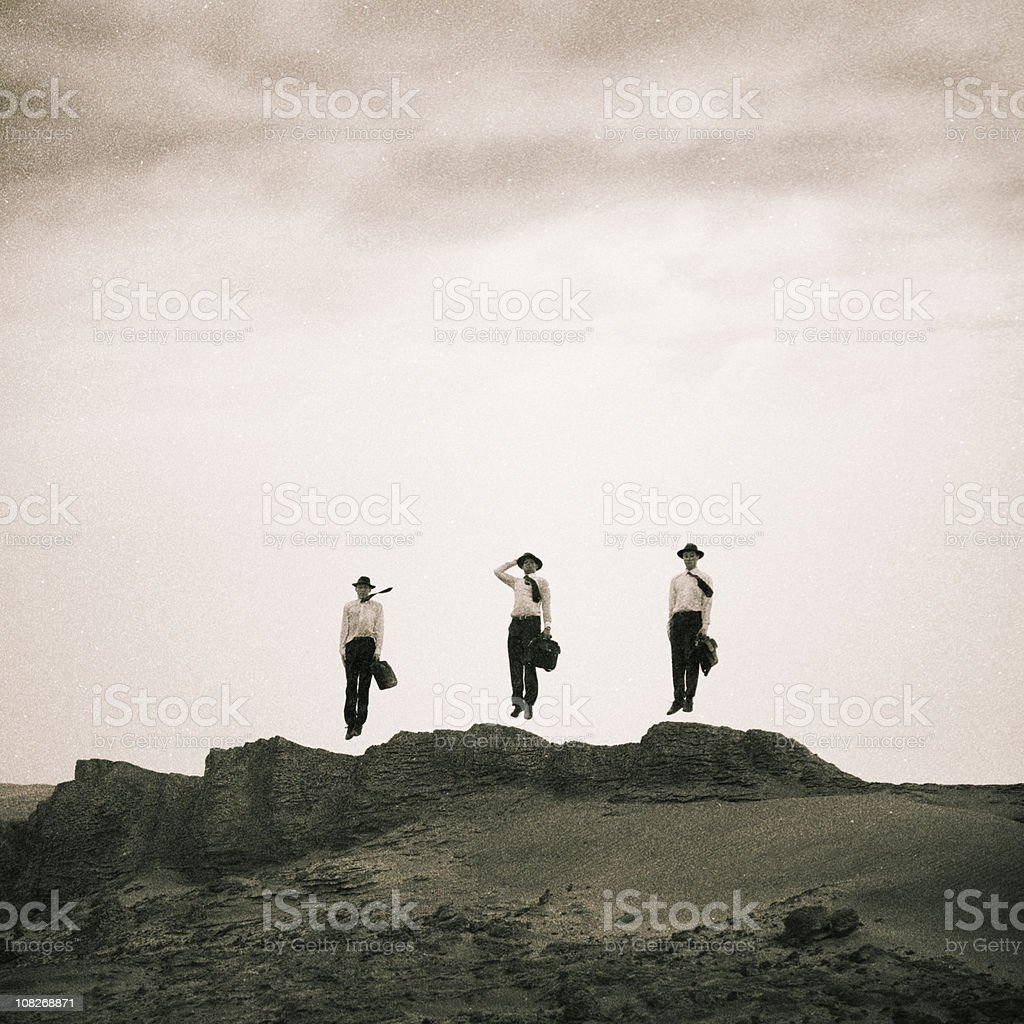 Three Men Jumping on Sand Dunes royalty-free stock photo