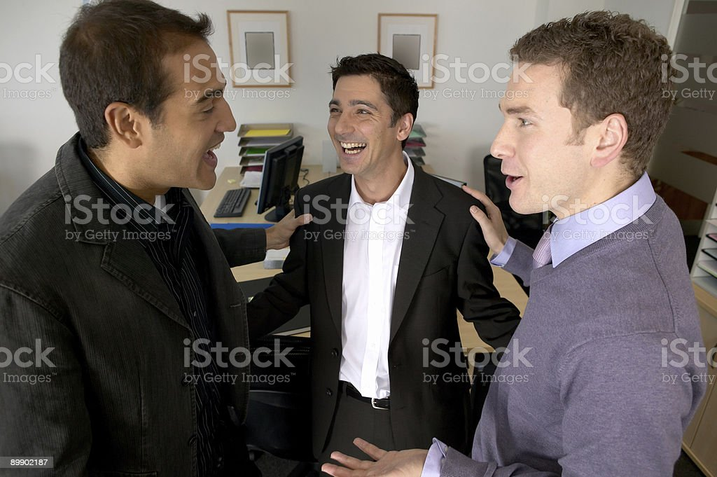 Three men laughing in office royalty-free stock photo