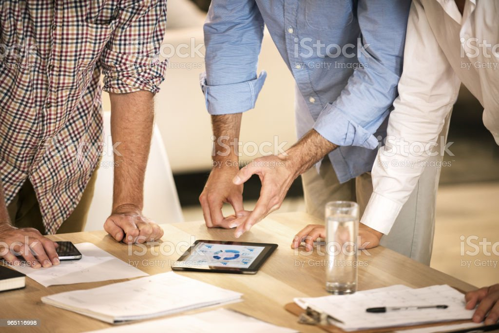Three men meeting to discuss business royalty-free stock photo
