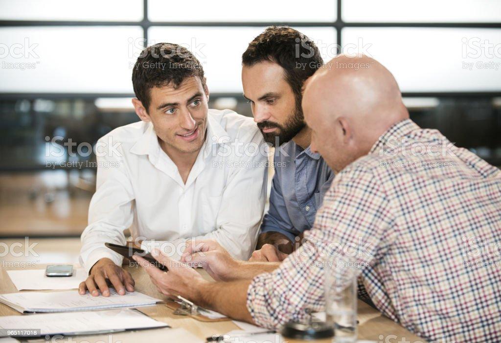 Three men meeting to discuss business zbiór zdjęć royalty-free