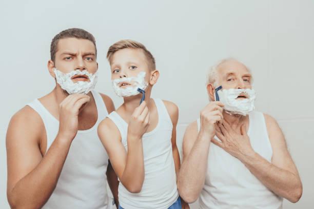 drei männer rasieren - papa humor stock-fotos und bilder