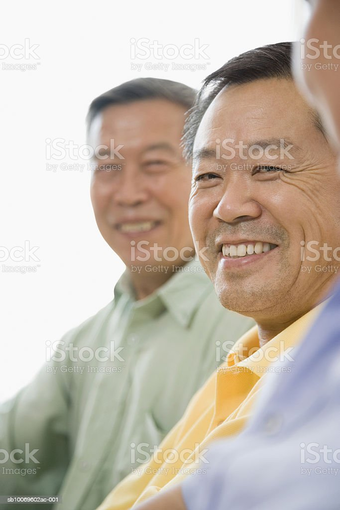 Three men smiling royalty-free stock photo