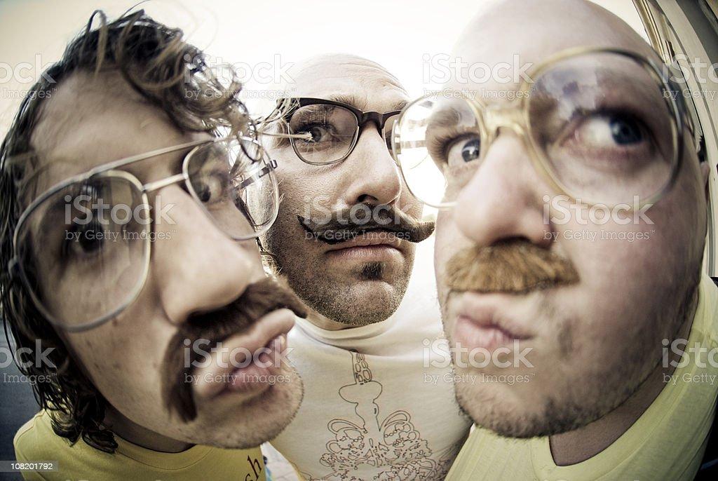 Three men staring royalty-free stock photo