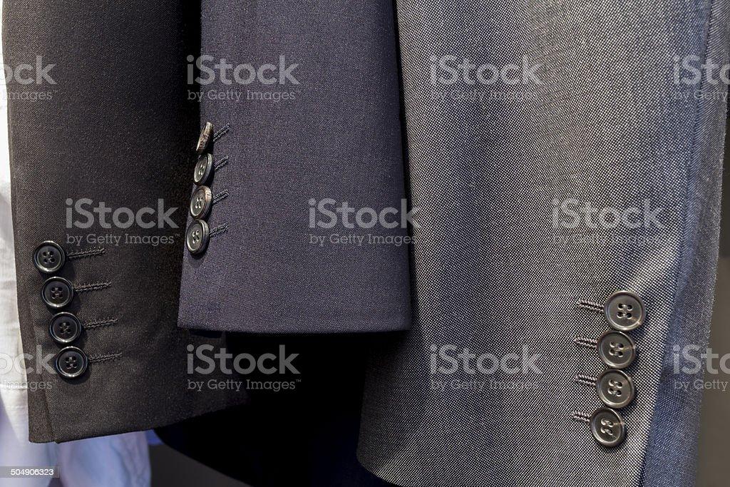 three men suit sleeves stock photo