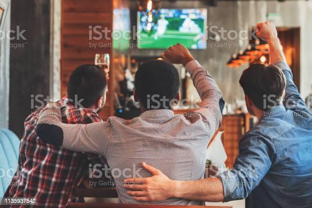 Three men watching football on tv in bar picture id1135937542?b=1&k=6&m=1135937542&s=612x612&h=n qyz3bvevjq9qoddu5glbugjxrjcytecm9fhea3xx4=