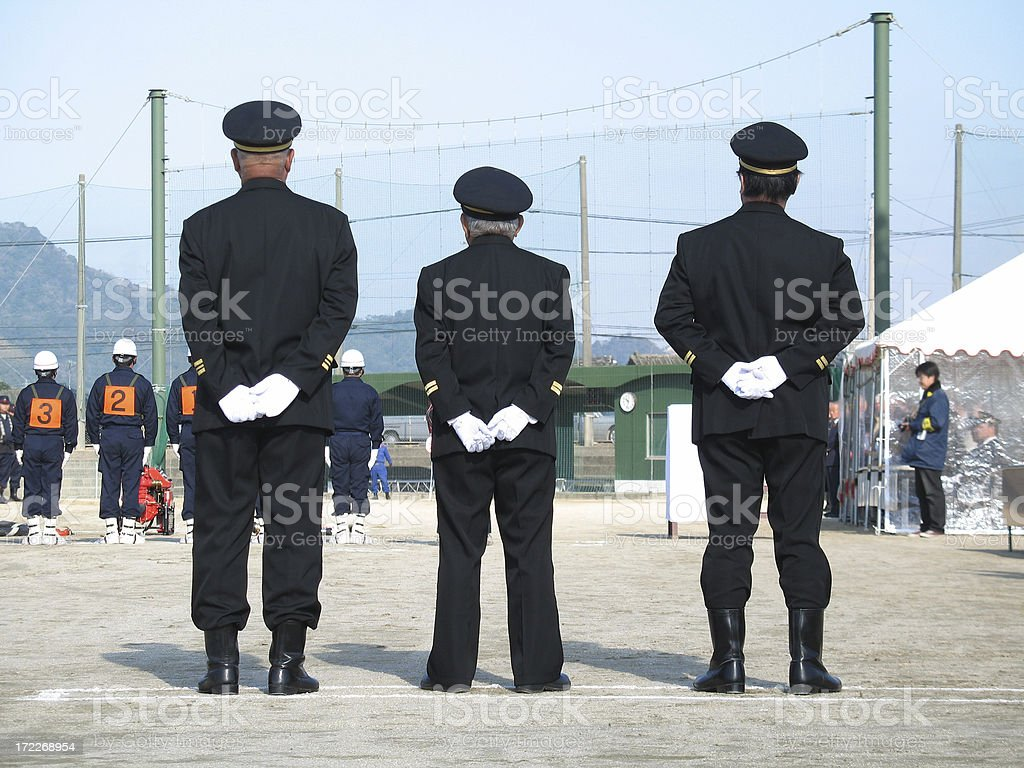 three men wearing uniform royalty-free stock photo