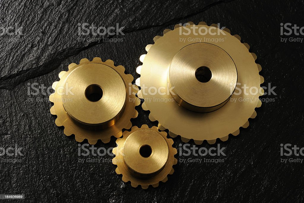 Three metal gears with black slate royalty-free stock photo