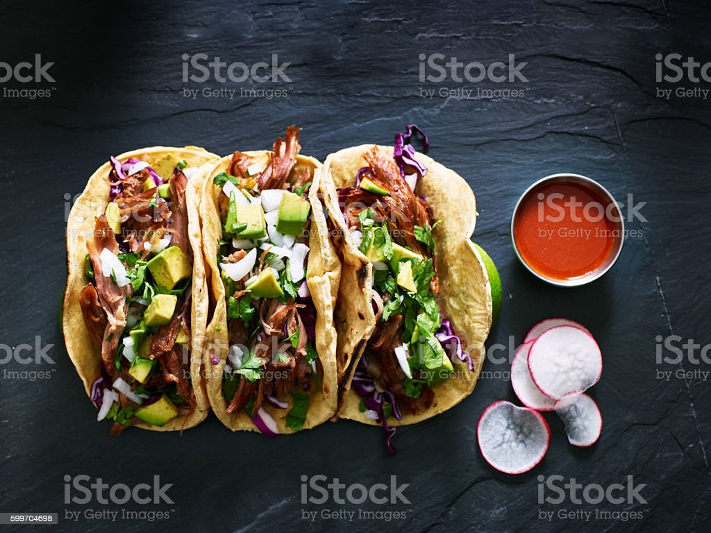 three mexican pork carnitas tacos flat lay composition ストックフォト