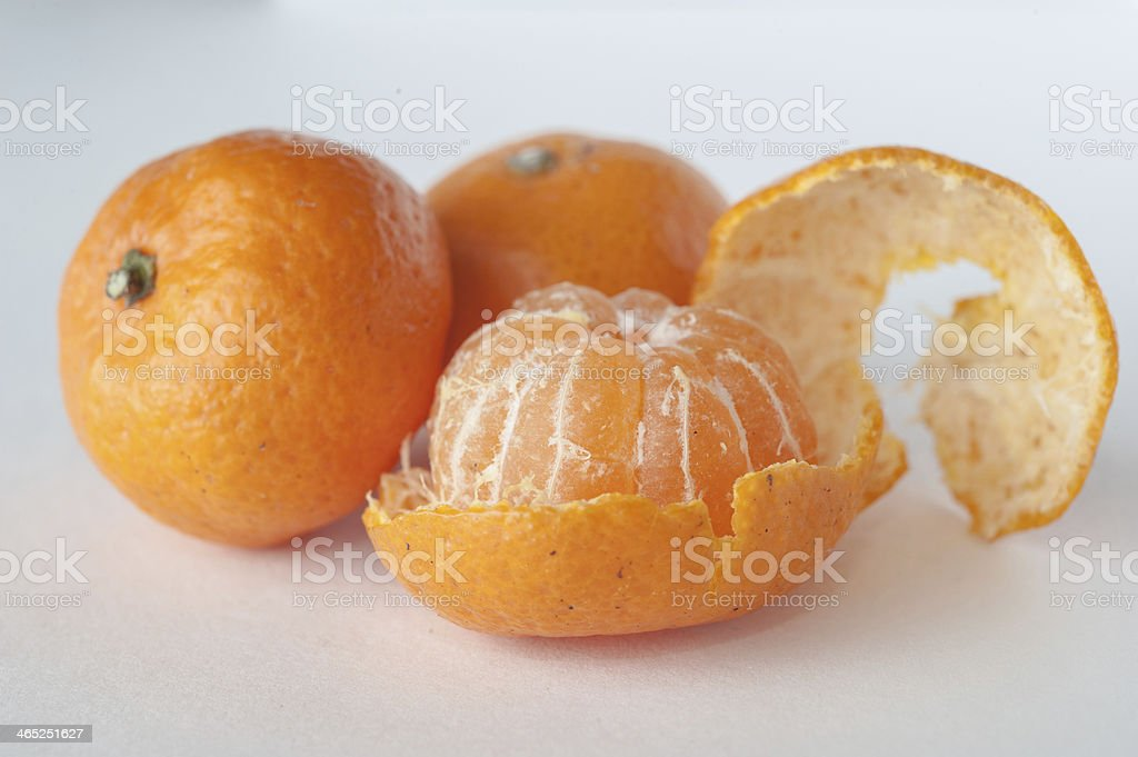 Three mini mandarin oranges stock photo