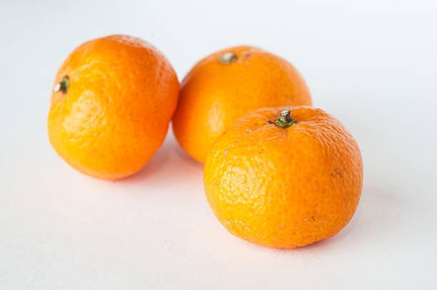Three mini mandarin oranges stock photo