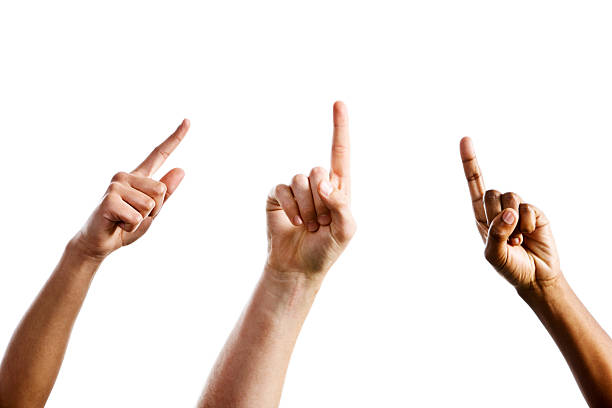three mixed hands point upward towards same unseen object - human finger stock pictures, royalty-free photos & images