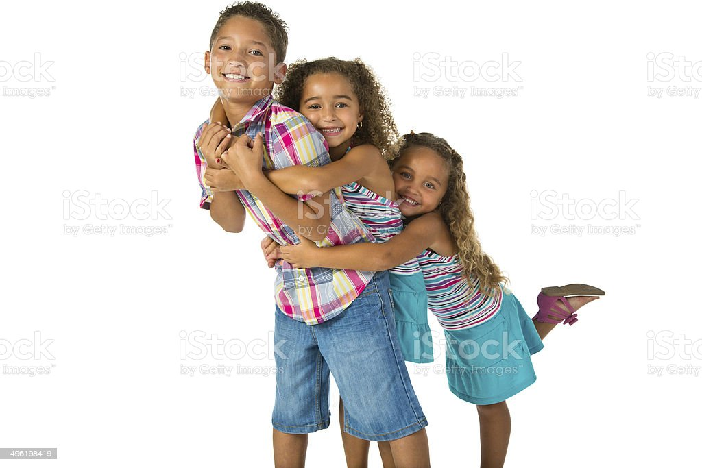Three mixed race siblings embracing, one behind the other stock photo