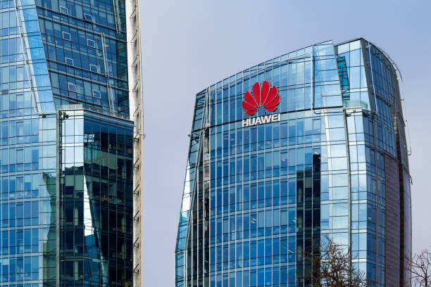 three modern office buildings with corporative logos in vilnius - huawei foto e immagini stock